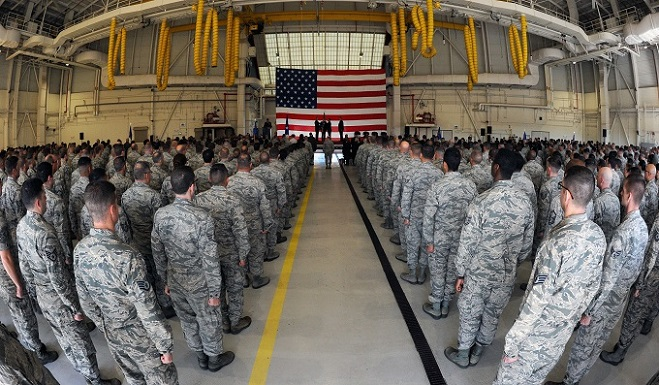 Airmen stand at a attention as a ceremonial guidon is passed to establish Col. Thomas M. Suelzer as the new wing commander during the 136th Airlift Wing Change of Command ceremony at Naval Air Station Fort Worth Joint Reserve Base, Texas, Dec. 2, 2017. Maj. Gen. David McMinn, Texas Air National Guard commander, presided over the ceremony. (Texas Air National Guard photo by Air Force Staff Sgt. Kristina Overton)